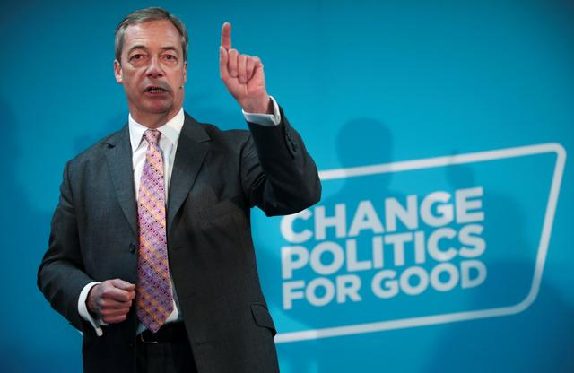 Brexit Party leader Nigel Farage speaks during a visit at a boxing gym in Ilford, Britain, November 13, 2019. REUTERS/Hannah McKay