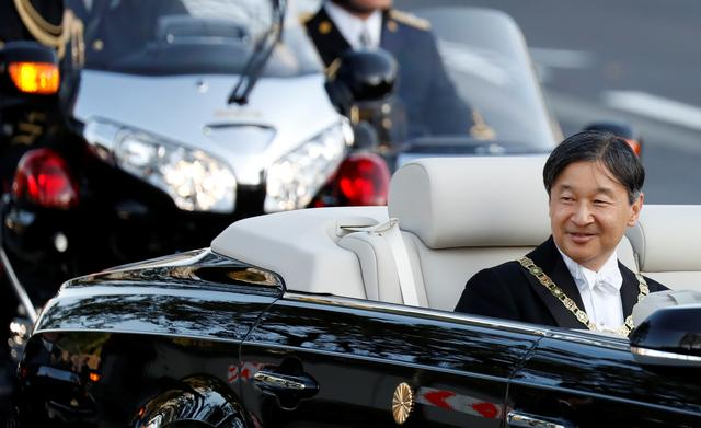 Japan's Emperor Naruhito rides in a car during the royal parade to mark the enthronement of Japanese Emperor Naruhito in Tokyo, Japan, November 10, 2019.  REUTERS/Issei Kato