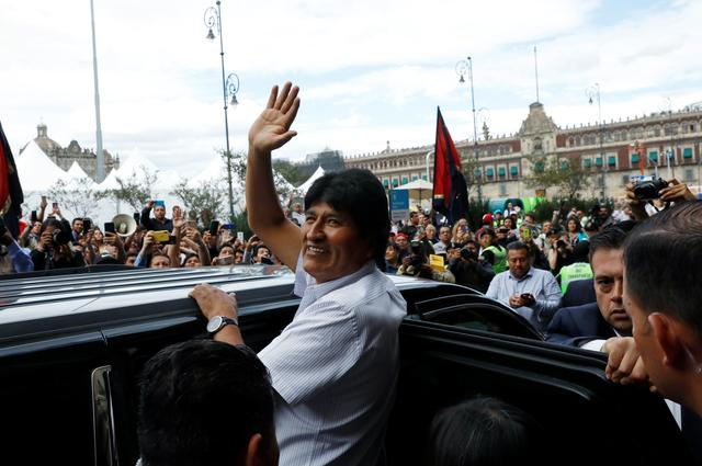 Bolivia's ousted president Evo Morales leaves after a ceremony where he was recognized as a distinguished guest, outside the town hall in Mexico City, Mexico, November 13, 2019. REUTERS/Carlos Jasso