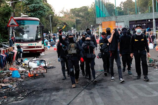 Anti-government protesters scout at a makeshift gate during a standoff with riot police at the Chinese University of Hong Kong, Hong Kong, China November 14, 2019. REUTERS/Tyrone Siu