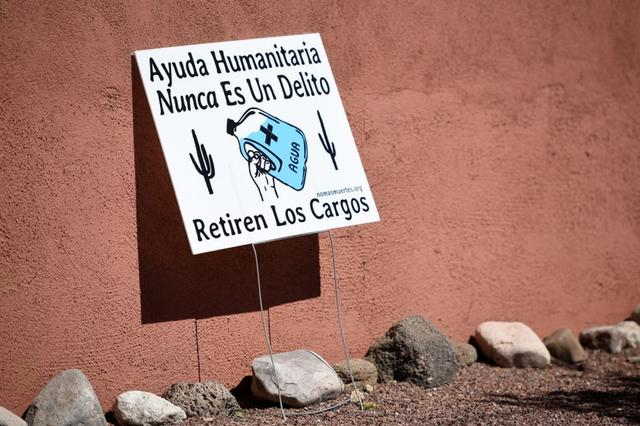 """FILE PHOTO: A yard sign in support of """"No Más Muertes/No More Deaths"""" is displayed in the neighborhood surrounding the Evo A. DeConcini U.S. Courthouse, where humanitarian volunteer Scott Warren faces charges of harboring, and conspiracy to transport undocumented migrants in Tucson, Arizona, U.S. May 29, 2019.  REUTERS/Caitlin O'Hara/File Photo"""