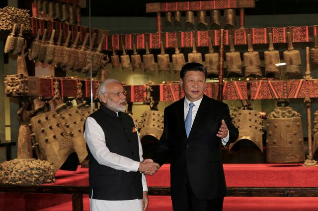 FILE PHOTO: Chinese President Xi Jinping and Indian Prime Minister Narendra Modi shake hands as they visit the Hubei Provincial Museum in Wuhan, Hubei province, China April 27, 2018. China Daily via REUTERS/File Photo