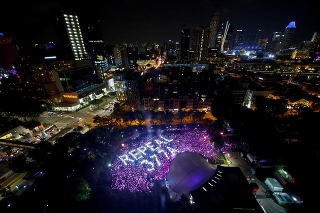 FILE PHOTO: File picture of participants at Pink Dot, an annual event organised in support of the LGBT community, gathering in  formation to call for the repeal of Section 377A of Singapore's Penal Code, in Singapore, June 29, 2019. REUTERS/Feline Lim -/File Photo