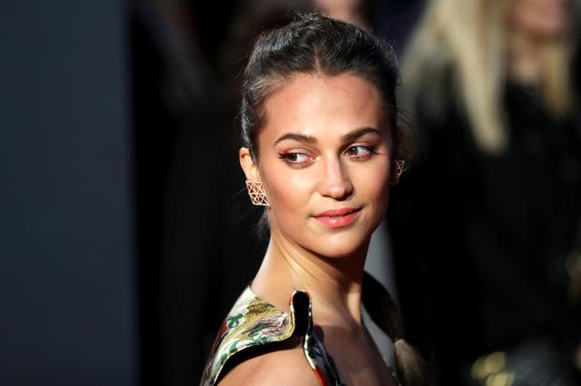 "FILE PHOTO: Alicia Vikander arrives for the European premiere of ""Tomb Raider"" in London, Britain March 6, 2018. REUTERS/Simon Dawson"