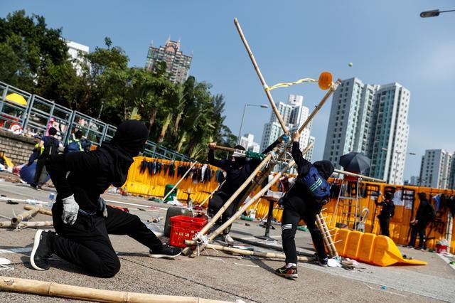 Student protesters use an improvised slingshot to fling tennis balls across a barricade as leisure at Hong Kong Baptist University, Hong Kong, China November 14, 2019. REUTERS/Thomas Peter