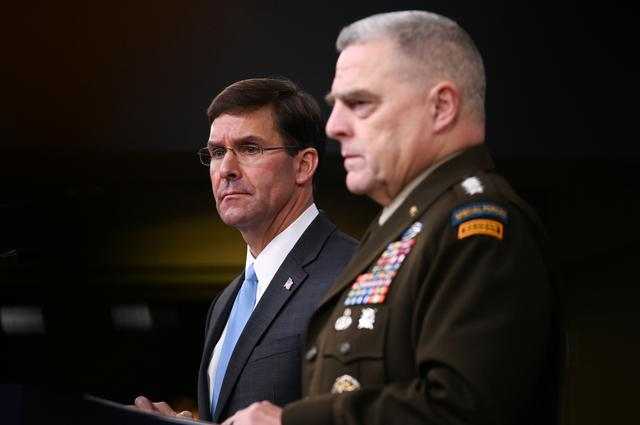FILE PHOTO: U.S. Defense Secretary Mark Esper and Joint Chiefs Chairman General Mark Milley address reporters during a media briefing at the Pentagon in Arlington, Virginia, U.S., October 11, 2019. REUTERS/Erin Scott/File Photo