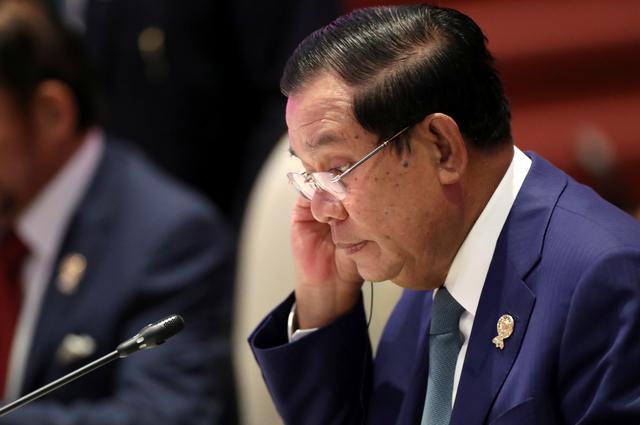 FILE PHOTO: Cambodia's Prime Minister Hun Sen attends an ASEAN leaders summit with United Nations Secretary-General Antonio Guterres, in Bangkok, Thailand November 3, 2019. REUTERS/Soe Zeya Tun/File Photo