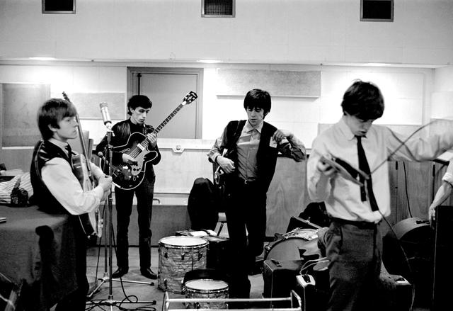 Brian Jones, Bill Wyman, Keith Richards and Mick Jagger of the Rolling Stones are seen at the De Lane Lea recording studios in 1963. Rare images of the Rolling Stones from 1963 will be on public display in London from 18 November until 2 December 2019. Gus Coral/Zebraonegallery.com via REUTERS