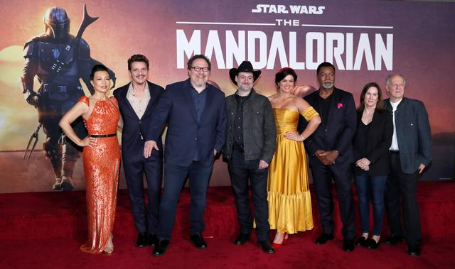 "FILE PHOTO: Creator Jon Favreau (3rd L), President of Lucasfilm Kathleen Kennedy (2nd R), executive producer Dave Filoni (C) pose with cast members (L-R) Ming-Na Wen, Pedro Pascal, Gina Carano, Carl Weathers and Werner Herzog at the premiere for the television series ""The Mandalorian"" in Los Angeles, California, U.S., November 13, 2019. REUTERS/Mario Anzuoni"