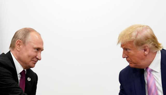 FILE PHOTO: U.S. President Donald Trump and Russian President Vladimir Putin hold a bilateral meeting at the G20 leaders summit in Osaka, Japan June 28, 2019.  REUTERS/Kevin Lamarque