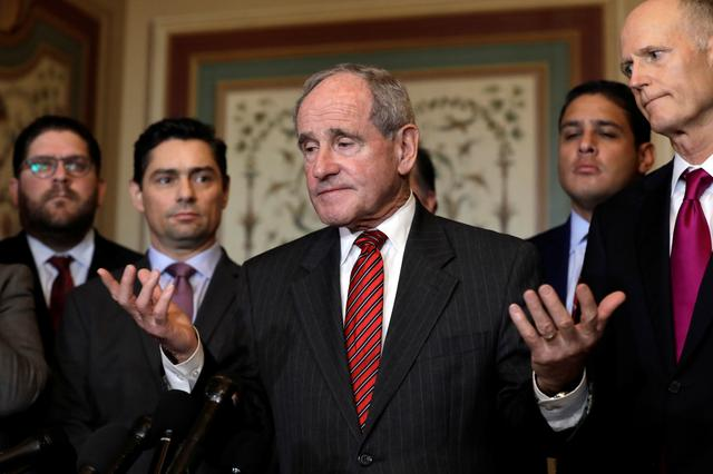 FILE PHOTO: U.S. Senate Foreign Relations Committee chairman Jim Risch (R-ID) talks to the media after a meeting with Carlos Alfredo Vecchio (2nd R), charge d'affaires appointed by Venezuela's opposition leader and self-proclaimed interim president Juan Guaido, on Capitol Hill in Washington, U.S., January 30, 2019. REUTERS/Yuri Gripas