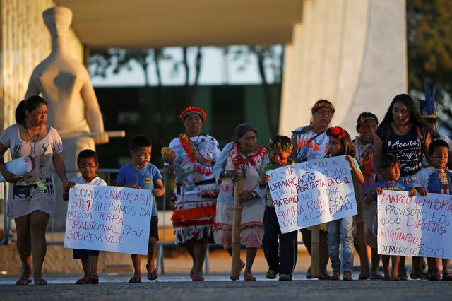 FILE PHOTO: Indigenous people from the Guarani Kaiowa tribe attend a protest to defend indigenous land, outside Brazil's Supreme Federal Court  in Brasilia, Brazil, June 26, 2019. REUTERS/Adriano Machado/File Photo