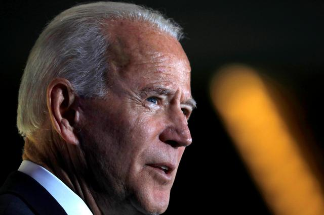 FILE PHOTO: Democratic presidential candidate former Vice President Joe Biden delivers a speech during the Women's Leadership Forum in Washington, U.S. October 17, 2019. REUTERS/Carlos Jasso/File Photo
