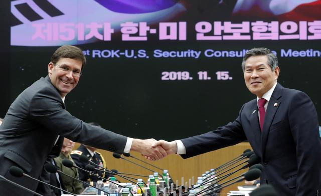 U.S. Defense Secretary Mark Esper and South Korean Defense Minister Jeong Kyeong-doo shake hands for the media prior to the 51st Security Consultative Meeting (SCM) at the Defense Ministry in Seoul, South Korea, Friday, November 15, 2019. Lee Jin-man/Pool via REUTERS