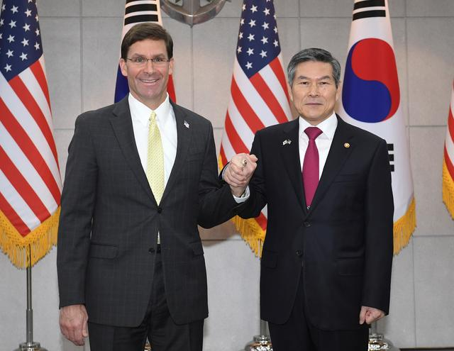 U.S. Defense Secretary Mark Esper (L) clasps hands with South Korean Defense Minister Jeong Kyeong-doo (R) before their meeting on November 15, 2019 in Seoul, South Korea. Kim Min-hee/Pool via REUTERS