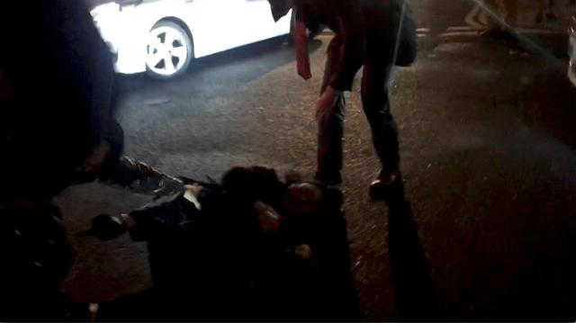 Hong Kong Justice Secretary Teresa Cheng falls after protesters surrounded her in London, Britain November 14, 2019, in this still image from video obtained via social media. Chloe Leung via REUTERS