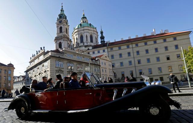 A vintage car with tourists drives through central Prague, Czech Republic, November 7, 2019.   REUTERS/David W Cerny