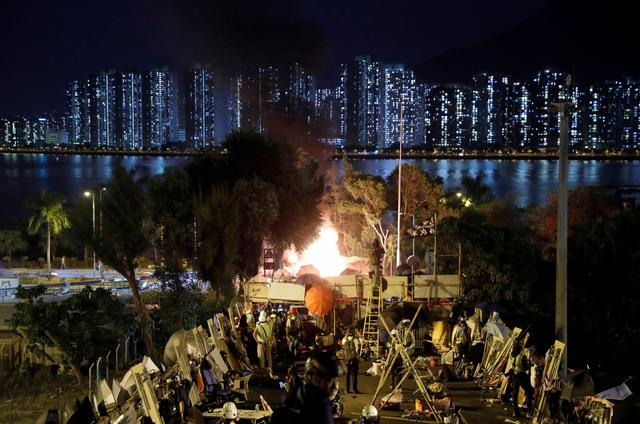 Explosives ignite an abandoned car, that were hidden there by protesters, near a barricade above the Tolo Highway next to the Chinese University campus in Hong Kong, China November 15, 2019. REUTERS/Thomas Peter