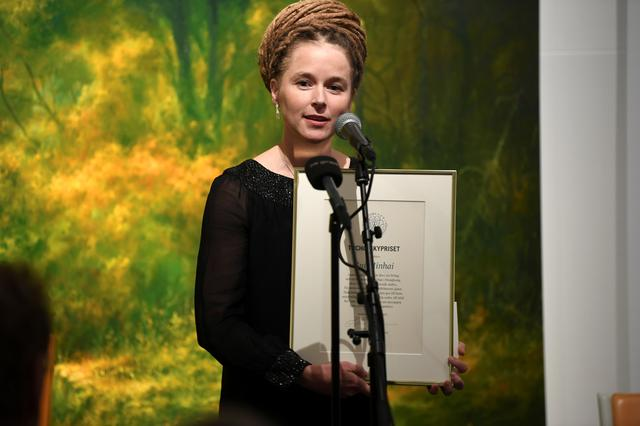 Swedish Culture and Democracy Minister Amanda Lind presents Svenska PEN's Tucholsky Prize to detained Swedish bookseller Gui Minhai in Stockholm, Sweden November 15, 2019. TT News Agency/Fredrik Sandberg via REUTERS      ATTENTION EDITORS - THIS IMAGE WAS PROVIDED BY A THIRD PARTY. SWEDEN OUT. NO COMMERCIAL OR EDITORIAL SALES IN SWEDEN.