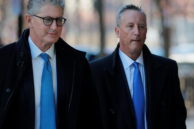 Martin Fox (R), a former president of a private tennis academy in Texas, arrives at the federal courthouse before entering a plea in a nationwide college admissions cheating scheme in Boston, Massachusetts, U.S., November 15, 2019.   REUTERS/Brian Snyder