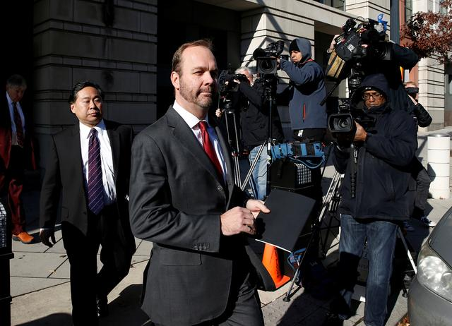 FILE PHOTO: Rick Gates, former campaign aide to U.S. President Donald Trump, departs after a bond hearing at U.S. District Court in Washington, U.S., December 11, 2017. REUTERS/Joshua Roberts