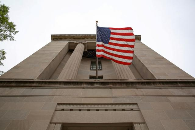FILE PHOTO: A general view of the Department of Justice building is seen ahead of the release of the Special Counsel Robert Mueller's report in Washington, U.S., April 18, 2019. REUTERS/Amr Alfiky/File Photo