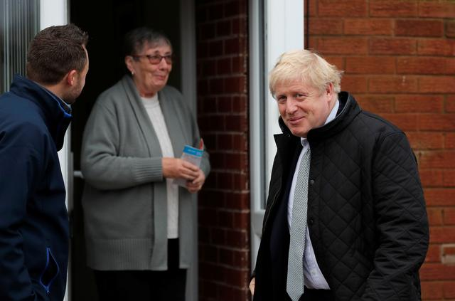 Britain's Prime Minister Boris Johnson with Conservative party candidate for the Mansfield constituency Ben Bradley campaigns in Mansfield, Britain, November 16, 2019. Frank Augstein/Pool via REUTERS