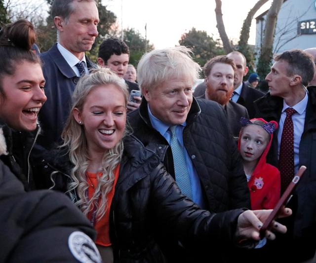 Britain's Prime Minister Boris Johnson poses for a photo during a general election campaign trail stop at Thornton-Cleveleys railway station in Manchester, Britain November 15, 2019. Frank Augstein/Pool via REUTERS