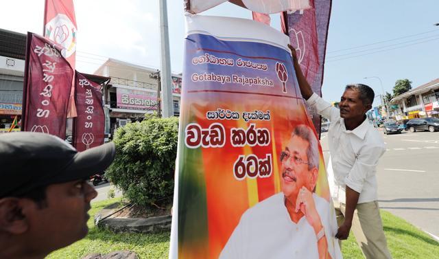 Supporters of Sri Lanka People's Front party presidential election candidate and former wartime defence chief Gotabaya Rajapaksa celebrate after he won the presidential election in Colombo, Sri Lanka November 17, 2019. REUTERS/Dinuka Liyanawatte