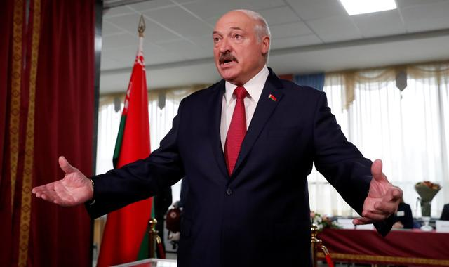 Belarusian President Alexander Lukashenko addresses the media after casting his vote during the parliamentary election in Minsk, Belarus November 17, 2019. REUTERS/Vasily Fedosenko