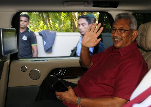 President-elect Gotabaya Rajapaksa waves at his supporters as he leaves his house in Colombo, Sri Lanka November 17, 2019. REUTERS/Stringer