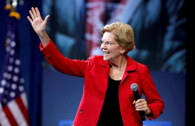 FILE PHOTO: U.S. Democratic presidential candidate Senator Elizabeth Warren (D-MA) arrives onstage during a forum held by gun safety organizations the Giffords group and March For Our Lives in Las Vegas, Nevada, U.S. October 2, 2019.  REUTERS/Steve Marcus/File Photo