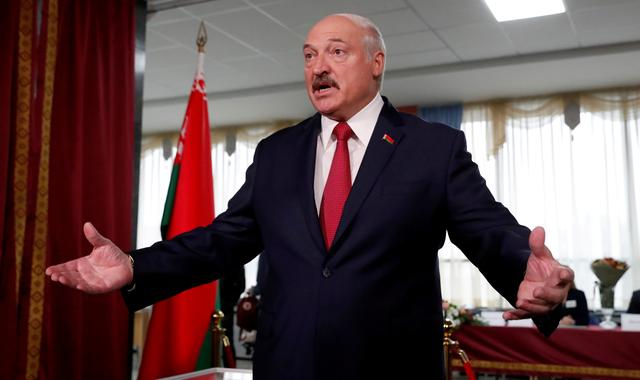 FILE PHOTO: Belarusian President Alexander Lukashenko addresses the media after casting his vote during the parliamentary election in Minsk, Belarus November 17, 2019. REUTERS/Vasily Fedosenko/File Photo