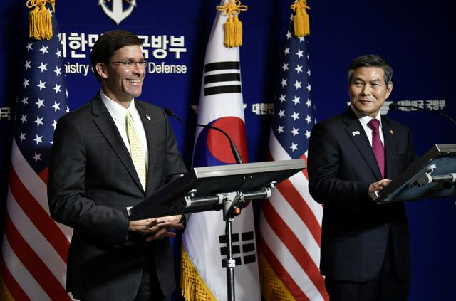 FILE PHOTO: U.S. Defense Secretary Mark Esper and South Korean Defence Minister Jeong Kyeong-doo hold a joint press conference after the 51st Security Consultative Meeting (SCM) at the Defence Ministry in Seoul on November 15, 2019. Jung Yeon-je/Pool via REUTERS/File Photo