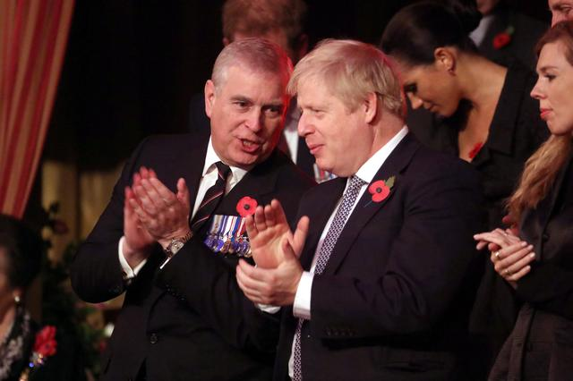 FILE PHOTO: Britain's Prince Andrew and Prime Minister, Boris Johnson, attend the Royal British Legion Festival of Remembrance at the Royal Albert Hall in London, Britain November 9, 2019. Chris Jackson/Pool via REUTERS