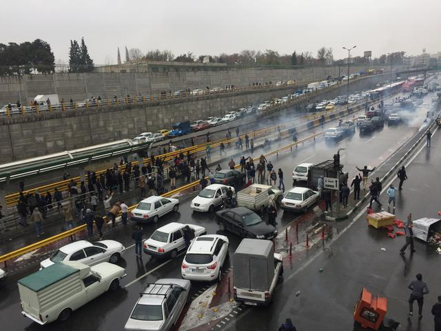 FILE PHOTO: People stop their cars in a highway to show their protest for increased gas price in Tehran, Iran November 16, 2019. Nazanin Tabatabaee/WANA (West Asia News Agency) via REUTERS