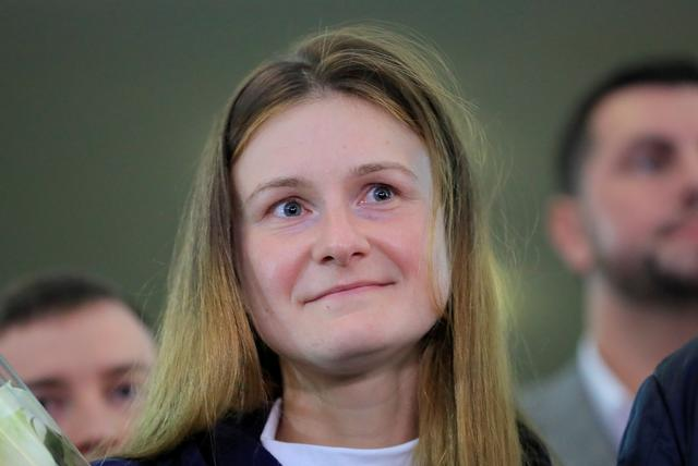 FILE PHOTO: Convicted Russian agent Maria Butina, who was released from a Florida prison and then deported by U.S. immigration officials, meets journalists upon the arrival at Sheremetyevo International Airport outside Moscow, Russia October 26, 2019. REUTERS/Tatyana Makeyeva/File Photo