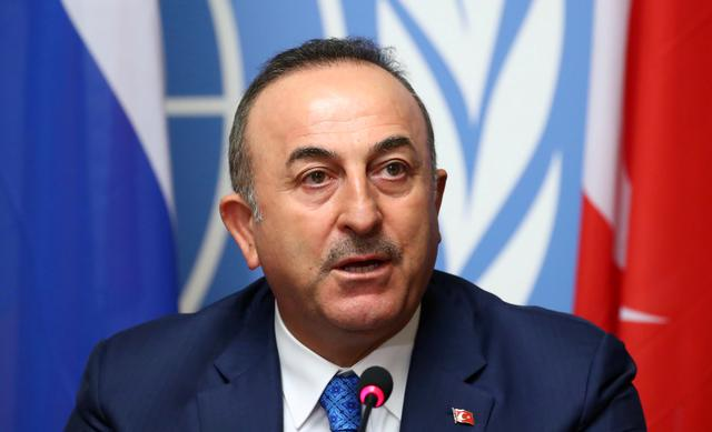 FILE PHOTO: Turkish Foreign Minister Mevlut Cavusoglu attends a news conference in Geneva, Switzerland, October 29, 2019. REUTERS/Denis Balibouse/File Photo