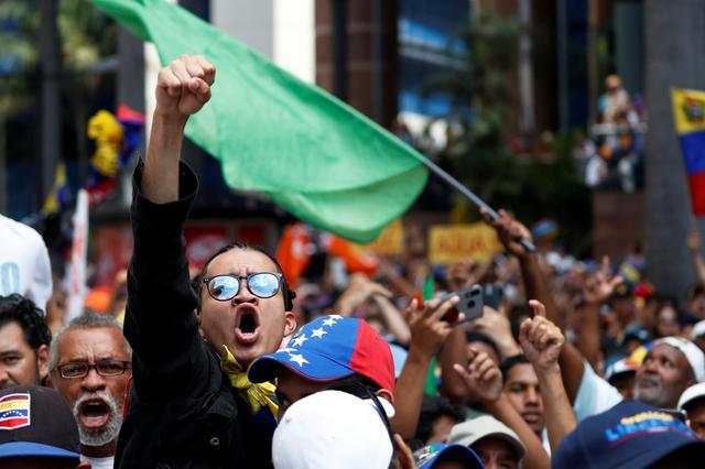 People take part in a protest march against Venezuela's President Nicolas Maduro in Caracas, Venezuela, November 16, 2019. REUTERS/Carlos Garcia Rawlins