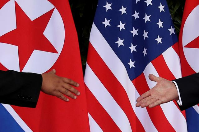 FILE PHOTO: U.S. President Donald Trump and North Korea's leader Kim Jong Un meet at the start of their summit at the Capella Hotel on the resort island of Sentosa, Singapore June 12, 2018. Picture taken June 12, 2018. REUTERS/Jonathan Ernst/File Photo