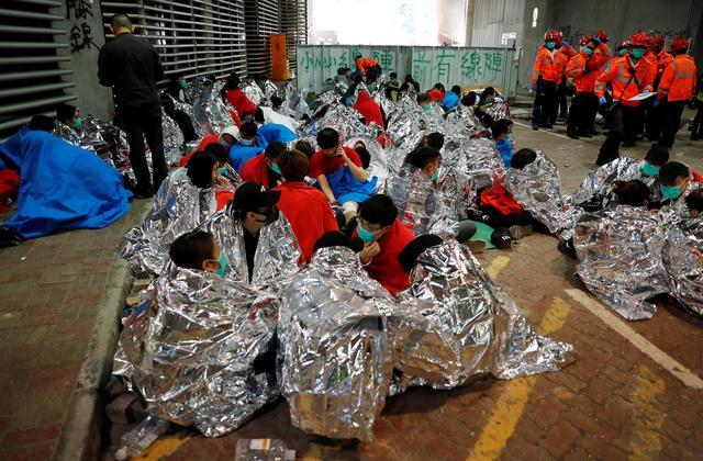 Protesters wait to receive medical attention at the Hong Kong Polytechnic University campus during protests in Hong Kong, China, November 19, 2019. REUTERS/Adnan Abidi