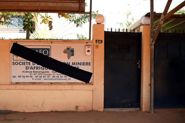 FILE PHOTO: The sign of Canadian gold miner Semafo is pictured covered in black in memory of the victims of an attack on a road leading to the Boungou mine, operated by the company, at its headquarters in Ouagadougou, Burkina Faso November 8, 2019. REUTERS/Anne Mimault/File Photo