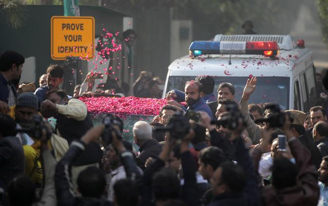 Supporters of Pakistan Muslim League-Nawaz (PML-N) sprinkle rose petals on a car carrying Former Prime Minister Nawaz Sharif, as he makes his way to the airport to travel for a medical treatment in the United Kingdom, outside his residence in Raiwind, near Lahore, Pakistan November 19, 2019. REUTERS/Mohsin Raza