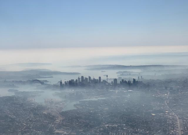 An image taken on a smart phone from a plane window shows smoke haze blanketing Sydney, Australia, November 19, 2019. AAP Image/Neil Bennett/via REUTERS