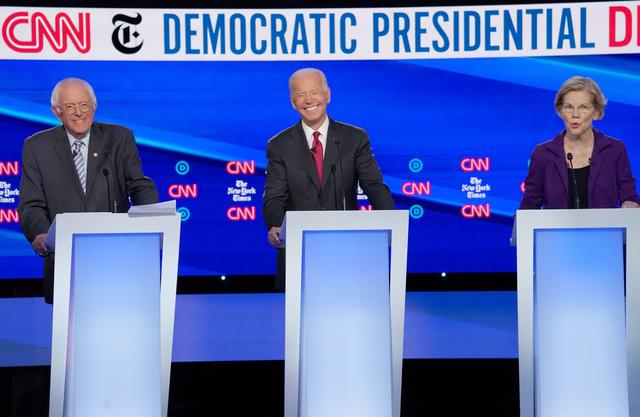 FILE PHOTO: Democratic presidential candidates Senator Bernie Sanders and former Vice President Joe Biden listen to Senator Elizabeth Warren as they debate during the fourth U.S. Democratic presidential candidates 2020 election debate in Westerville, Ohio, U.S., October 15, 2019. REUTERS/Shannon Stapleton/
