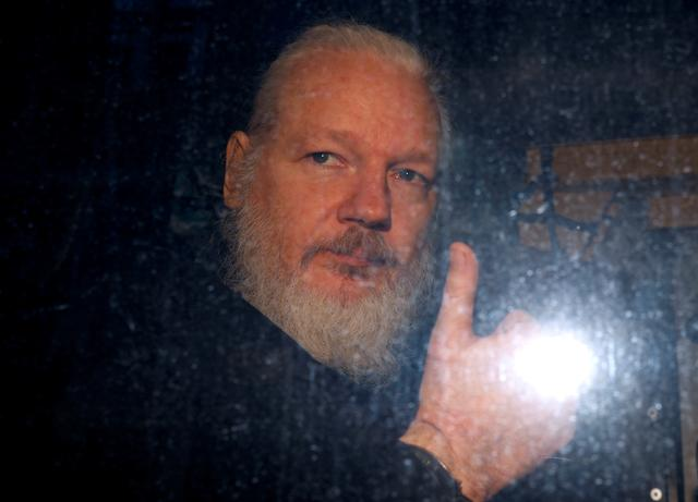 FILE PHOTO: WikiLeaks founder Julian Assange is seen as he leaves a police station in London, Britain April 11, 2019. REUTERS/Peter Nicholls/File Photo