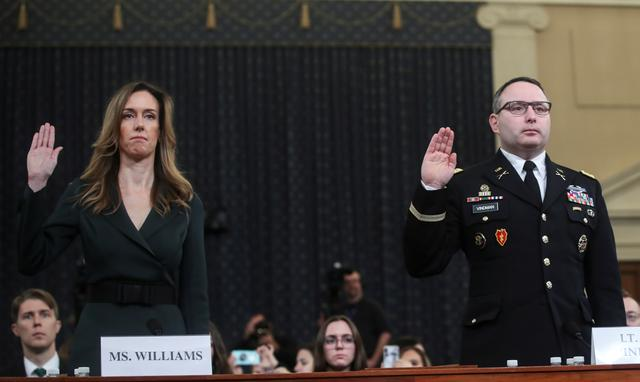 Jennifer Williams, a special adviser to Vice President Mike Pence for European and Russian affairs and Alexander Vindman, director for European Affairs at the National Security Council, are sworn in to testify before a House Intelligence Committee hearing as part of the impeachment inquiry into U.S. President Donald Trump on Capitol Hill in Washington, U.S., November 19, 2019. REUTERS/Jonathan Ernst