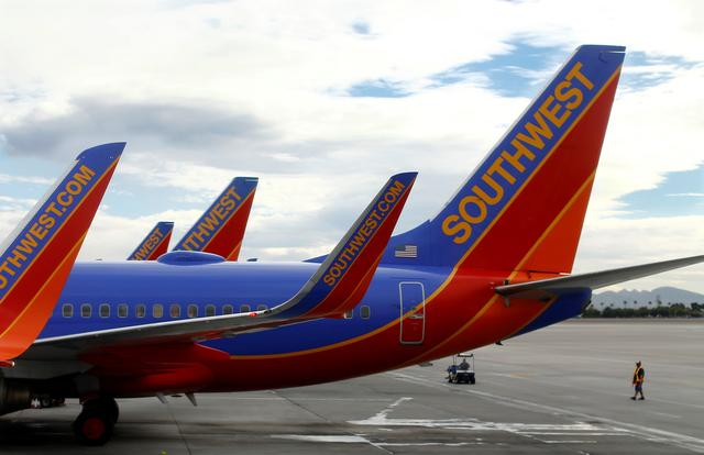 FILE PHOTO: Southwest commercial airliners taxied at McCarran International Airport in Las Vegas, November 19, 2014.  REUTERS/Mike Blake/