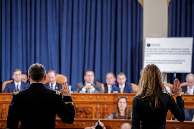 Jennifer Williams, an aide to Vice President Mike Pence, and National Security Council aide Lt. Col. Alexander Vindman, are sworn in to testify before the House Intelligence Committee as part of the impeachment inquiry into U.S. President Donald Trump on Capitol Hill in Washington, U.S., November 19, 2019. Shawn Thew/Pool via REUTERS