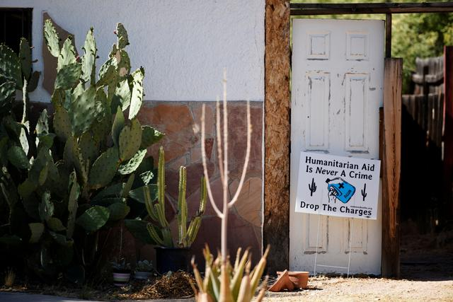"FILE PHOTO: A yard sign in support of ""No Más Muertes/No More Deaths"" is displayed in the neighborhood surrounding the Evo A. DeConcini U.S. Courthouse, where humanitarian volunteer Scott Warren faces charges of harboring, and conspiracy to transport undocumented migrants in Tucson, Arizona, U.S. May 29, 2019.  REUTERS/Caitlin O'Hara/File Photo"